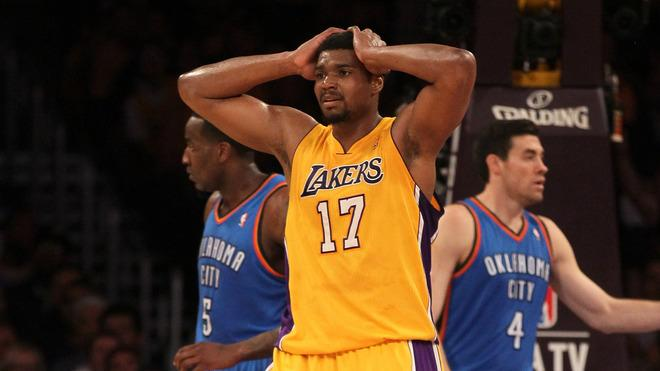 Andrew Bynum #17 Of The Los Angeles Lakers Reacts Getty Images