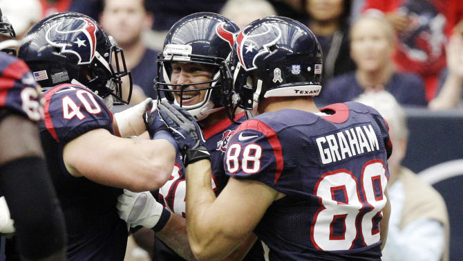 Houston Texans fullback James Casey, center, celebrates his touchdown with Tyler Clutts (40) and Garrett Graham (88) during the second quarter of an NFL football game, Sunday, Nov. 18, 2012, in Houston. (AP Photo/Patric Schneider)