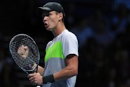 Czech Republic's Tomas Berdych celebrates beating France's Jo-Wilfried Tsonga during their group A singles match in the round robin stage on the third day of the ATP World Tour Finals tennis tournament in London