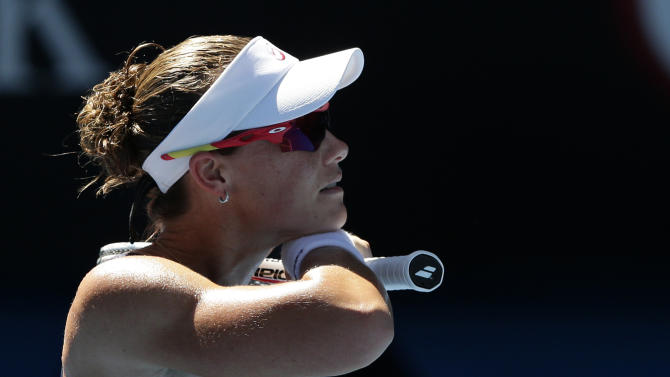 Australia's Samantha Stosur wipes the sweat from her face during her second round match against China's Zheng Jie at the Australian Open tennis championship in Melbourne, Australia, Wednesday, Jan. 16, 2013. (AP Photo/Andy Wong)
