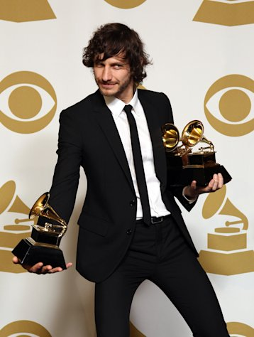Gotye poses backstage with the awards for best pop duo/group performance of the year and record of the year for &quot;Somebody That I Used to Know&quot; at the 55th annual Grammy Awards on Sunday, Feb. 10, 2013, in Los Angeles. (Photo by Matt Sayles/Invision/AP)