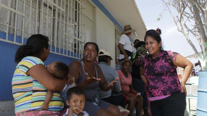 Evacuees are seen in a school used as a shelter in Cabo San Lucas, after Hurricane Odile hit in Baja California