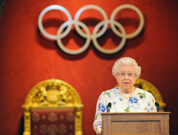 Britain's Queen Elizabeth II speaks at a reception for members of the International Olympic Committee, at Buckingham Palace, Monday, July 23, 2012, in London. Opening ceremonies for the 2012 London Olympics will be held Friday, July 27. (AP Photo/Dominic Lipinksi, PA) UNITED KINGDOM OUT