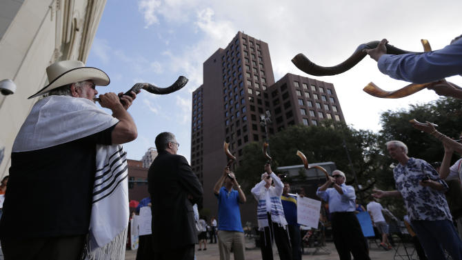 Opponents of a proposed nondiscrimination ordinance sound shofars and pray outside the city council chambers, Thursday, Sept. 5, 2013, in San Antonio. The San Antonio City Council is expected to vote Thursday on an ordinance which in part would prohibit discrimination based on sexual orientation and gender identity. (AP Photo/Eric Gay)