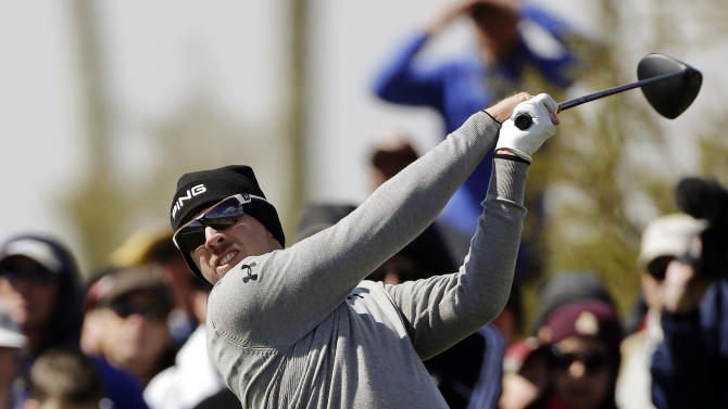 Hunter Mahan tees off the eighth hole in the final round of play against Matt Kuchar during the Match Play Championship golf tournament, Sunday, Feb. 24, 2013, in Marana, Ariz. Kuchar won 2 and 1. (AP Photo/Ted S. Warren)