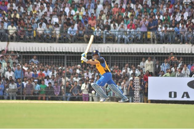 Virender Sehwag bats during N K P Salve Challenger Trophy between India Blue and Delhi at Holkar Cricket Stadium in Indore on Sept. 26, 2013. (Photo: IANS)