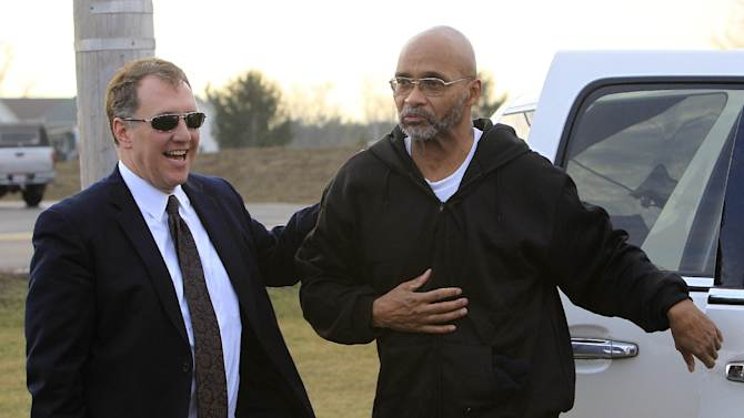 Doug Prade, right, a former Ohio police captain who has spent nearly 15 years in prison for his ex-wife's killing, is greeted by his attorney Mark Godsey after being released from the Madison Correctional Institution Tuesday, Jan. 29, 2013, in London, Ohio. Prade was exonerated by DNA testing. (AP Photo/Jay LaPrete)