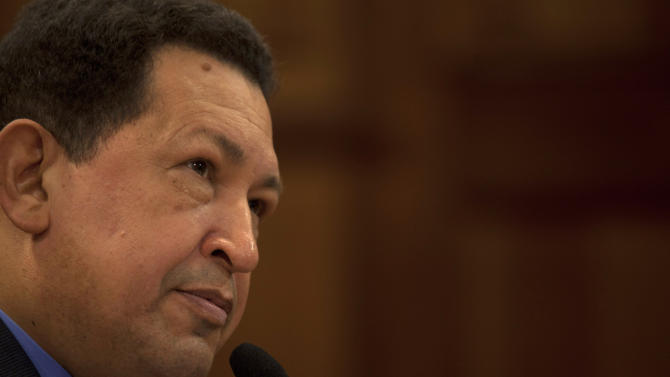FILE - In this Tuesday, Oct. 9, 2012 file photo, Venezuela's President Hugo Chavez, during a press conference at the Miraflores palace in Caracas, Venezuela.  Venezuelan President Hugo Chavez has arrived back home in Caracas after 10 days of medical treatment in Cuba. State television showed images of Chavez arriving at Caracas' airport early Friday, Dec. 7, 2012,  and walking down the steps of the presidential jet. (AP Photo/Nicolas Garcia, File)