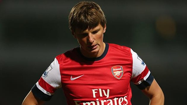 Arsenal's Andrey Arshavin stands dejected (PA)