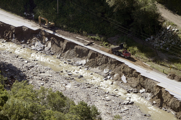 In this aerial photo workers grade an alternate roadbed alongside Route 4 in Mendon, Vt., Tuesday, Aug. 30, 2011, washed out by flood waters from Tropical Storm Irene Sunday. Vermont Emergency Managem