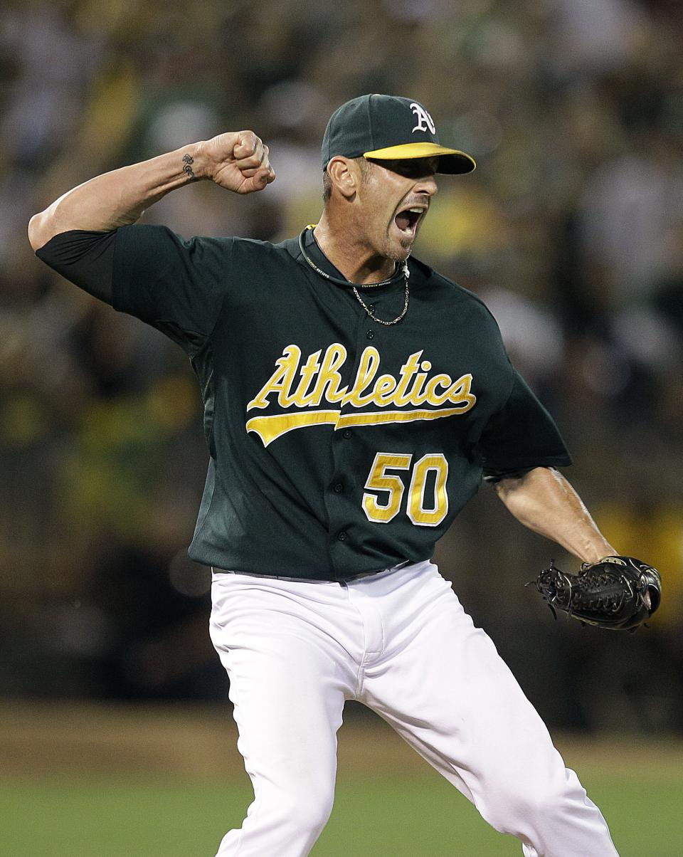 Oakland Athletics' Grant Balfour celebrates after the team clinched a wild card berth in the American League at the end of a baseball game against the Texas Rangers Monday, Oct. 1, 2012, in Oakland, Calif. (AP Photo/Ben Margot)