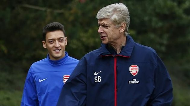 Arsenal manager Arsene Wenger (R) arrives for a team training session with Mesut Ozil (Reuters)