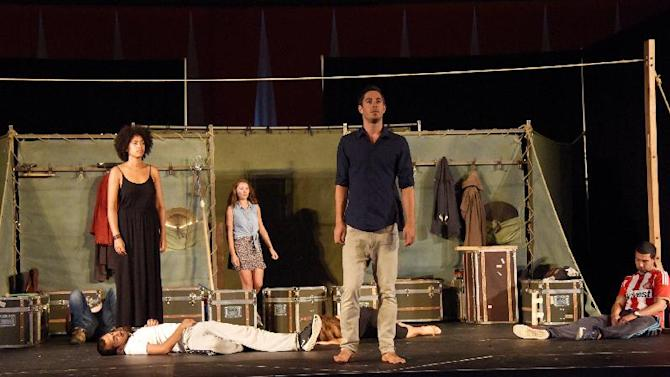 "This image released by British Consulate-General shows the cast of Shakespeare's Globe production of ""Hamlet,"" during a rehearsal at the United Nations of Monday, Aug. 4, 2014. (AP Photo/British Consulate-General, Russ Rowland)"