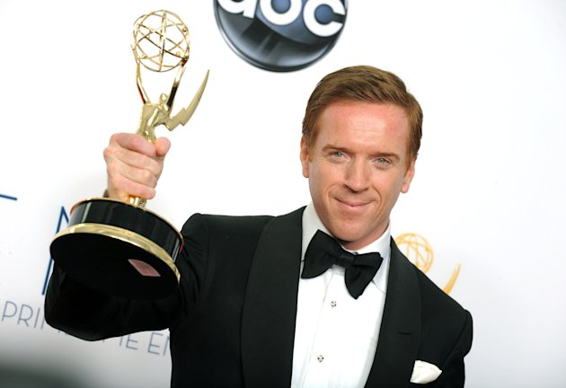 "Actor Damien Lewis, winner of the Outstanding Lead Actor In A Drama Series award for ""Homeland,"" poses backstage at the 64th Primetime Emmy Awards at the Nokia Theatre on Sunday, Sept. 23, 2012, in Los Angeles. (Photo by Jordan Strauss/Invision/AP)"