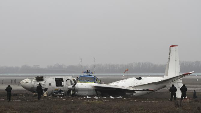 A general view of a damaged twin-engined Antonov turboprop plane, which broke up during an emergency landing the day before, is seen near the landing strip of the airport in Donetsk