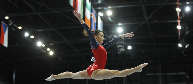 Alicia Sacramone of the U.S. perfroms on the beam during the women's qualifying session for the World Gymnastics Championships in Rotterdam, Netherlands, Sunday Oct. 17, 2010. (AP Photo/Bas Czerwinski