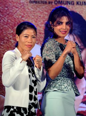 World champion boxer Mary Kom (L) and Bollywood actress …