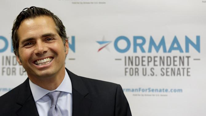 FILE - In this July 10, 2014 file photo Kansas Independent Senate candidate Greg Orman speaks in Shawnee, Kansas. Orman, running a surprisingly competitive race for the Senate in Kansas, has based his campaign on his disdain for both major political parties. But the parties have something the suburban Kansas City businessman could really use right now, and doesn't have: an established machine for getting out the vote. (AP Photo/Charlie Riedel, File)