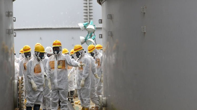Nuclear watchdog members inspect contaminated water tanks the Fukushima Dai-ichi nuclear power plant on August 23, 2013