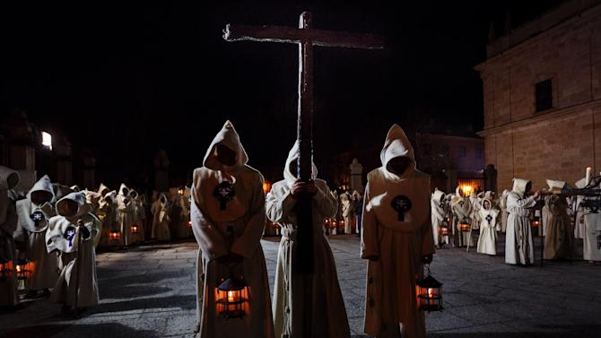 Penitents of the Santisimo Cristo del Espiritu Santo brotherhood take part in a Holy Week procession in Zamora, Spain, Friday, March 27, 2015. Hundreds of processions take place throughout Spain during the Easter Holy Week. (AP Photo/Daniel Ochoa de Olza)