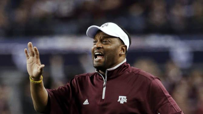 Texas A&M coach Kevin Sumlin calls out to his defense during the first half against Oklahoma in the Cotton Bowl NCAA college football game Friday, Jan. 4, 2013, in Arlington, Texas. (AP Photo/Tony Gutierrez)