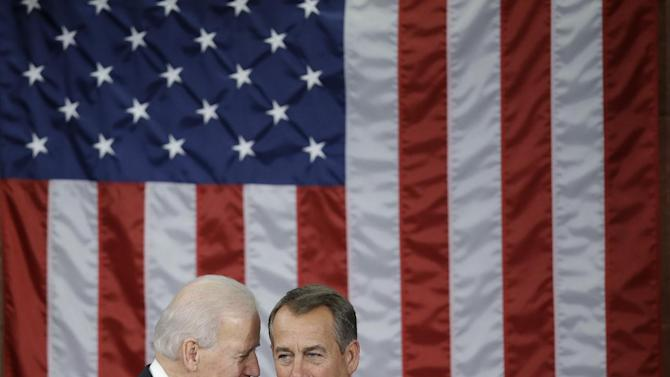 Vice President Joe Biden talks with House Speaker John Boehner of Ohio before President Barack Obama's State of the Union address during a joint session of Congress on Capitol Hill in Washington, Tuesday Feb. 12, 2013. (AP Photo/Pablo Martinez Monsivais)