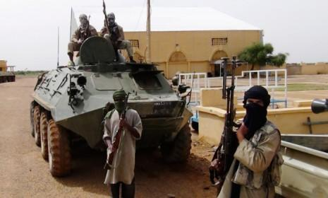 Fighters from the terror group Al Qaida in the Islamic Maghreb travel with a convoy in northern Mali on Aug. 7.