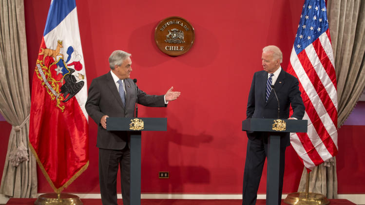 Chile's President Sebastian Pinera, left, speaks alongside Vice President Joe Biden at Moneda Palace in Santiago, Chile, Monday, March 10, 2014. Biden traveled to Chile to attend Tuesday's swearing-in of Michelle Bachelet as Chile's president. (AP Photo/Victor R. Caivano)