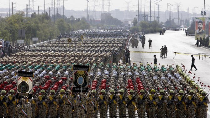 Iranian army troops march in a military parade commemorating the start of the Iraq-Iran war 32 years ago, in front of the mausoleum of the late revolutionary founder Ayatollah Khomeini, just outside Tehran, Iran, Friday, Sept. 21, 2012. (AP Photo/Vahid Salemi)