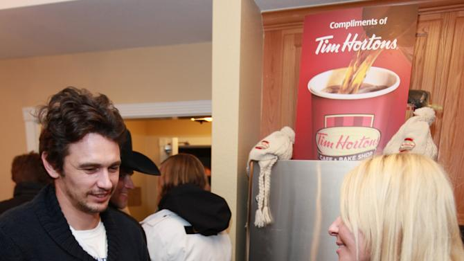 Actor James Franco visits the Tim Hortons cafe and bake shop coffee bar at the Fender Music lodge during the Sundance Film Festival on Sunday, Jan. 20, 2013, in Park City, Utah. (Photo by Barry Brecheisen/Invision for Fender/AP Images)