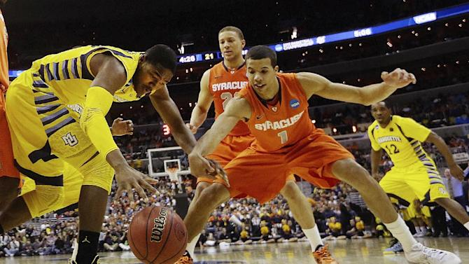 Marquette forward Steve Taylor Jr., (25) and Syracuse guard Michael Carter-Williams (1) reach for a loose ball during the first half of the East Regional final in the NCAA men's college basketball tournament, Saturday, March 30, 2013, in Washington. (AP Photo/Pablo Martinez Monsivais)