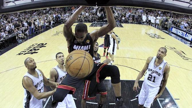 Miami Heat's Chris Bosh (1) dunks against the San Antonio Spurs during the first half at Game 4 of the NBA Finals basketball series, Thursday, June 13, 2013, in San Antonio. (AP Photo/Lucy Nicholson, Pool)