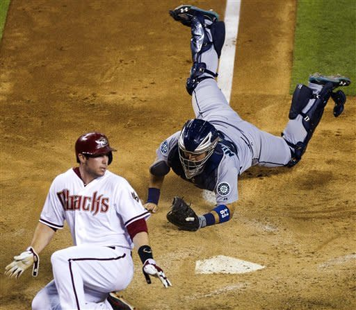 Hill's cycle sends D-backs past Seattle 7-1