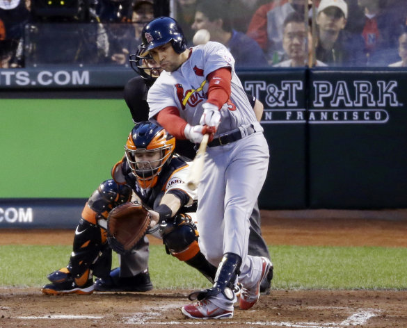 St. Louis Cardinals&#39; Carlos Beltran hits a two-run home run during the fourth inning of Game 1 of baseball&#39;s National League championship series against the San Francisco Giants Sunday, Oct. 14, 2012, in San Francisco. (AP Photo/Mark Humphrey)