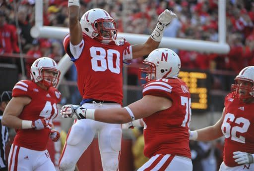 Martinez leads No. 16 Nebraska past Gophers 38-14