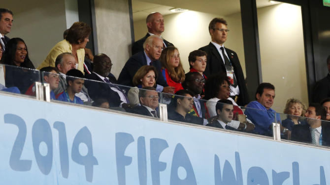 U.S. Vice President Joe Biden, center, watches the group G World Cup soccer match between Ghana and the United States at the Arena das Dunas in Natal, Brazil, Monday, June 16, 2014. (AP Photo/Julio Cortez)