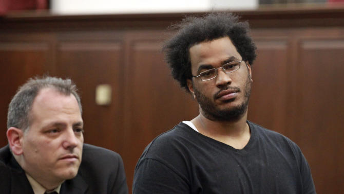 """Jose Pimentel, 27, right, represented by attorney Joseph Zablocki, left, is arraigned at Manhattan criminal court, Sunday, Nov. 20, 2011, in New York. Pimentel, 27, an """"al-Qaida sympathizer"""" accused of plotting to bomb police and post offices in New York City as well as U.S. troops returning home, was charged with criminal possession of explosive devices with the intent to use in a terrorist manner. (AP Photo/Jefferson Siegel, Pool)"""