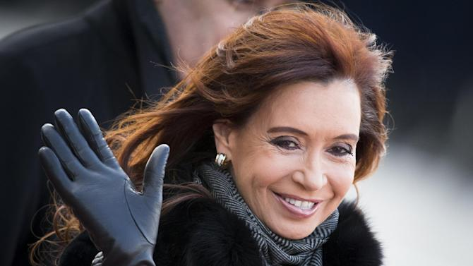 Argentina's President Cristina Fernandez  greets journalists as she arrives at Vnukovo government airport outside Moscow, Russia, Tuesday, April 21, 2015. (AP Photo/Alexander Zemlianichenko)