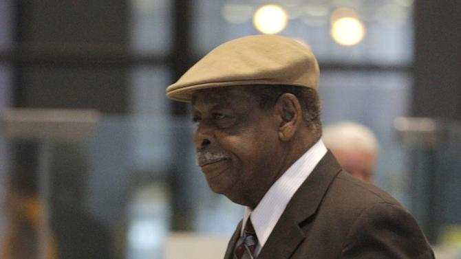 Cook County Commissioner William Beavers arrives at the federal courthouse Tuesday Dec. 4, 2012 in Chicago, for jury selection on the second day of his tax evasion trial. The 77-year-old Democrat is accused of diverting tens of thousands of dollars from campaign accounts for personal use without reporting it as income on tax returns and of then attempting to cover up the deeds. (AP Photo/M. Spencer Green)