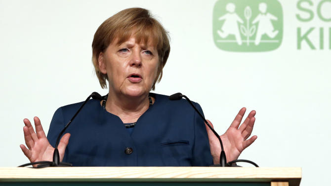 Merkel faces attacks over cost of election pledges