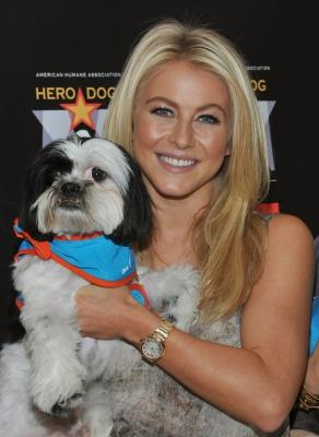"Julianne Hough and a friend kick off the voting campaign for America's First Ever National ""Hero Dog Awards"" at VA Medical Center - Manhattan in New York City on June 20, 2011  -- Getty Images"