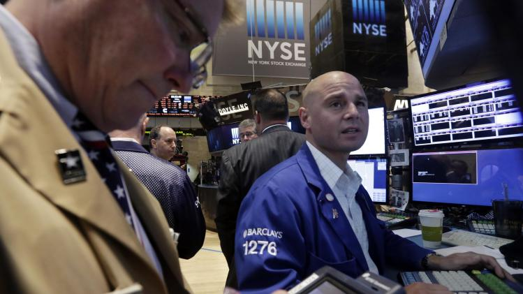 Specialist Mario Picone, right, works at his post on the floor of the New York Stock Exchange Friday, Aug. 1, 2014. U.S. markets are moving lower, extending a major sell-off from the day before. (AP Photo/Richard Drew)