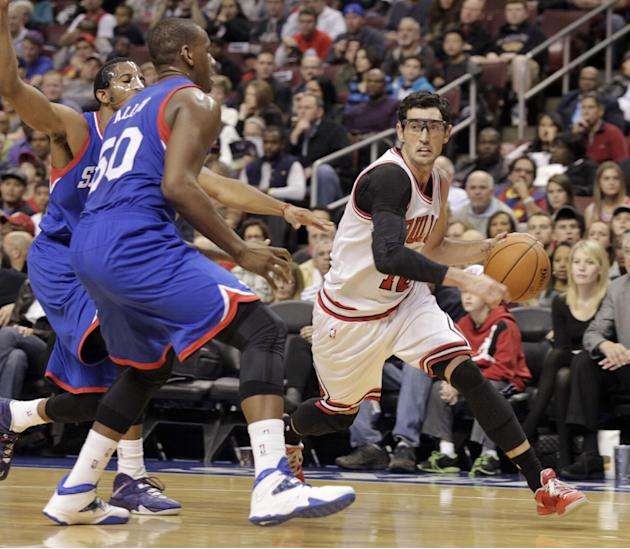 Chicago Bulls' Kirk Hinrich, right, drives against  Philadelphia 76ers' Lavoy Allen (50) in the first half of an NBA basketball game Saturday, Nov. 2, 2013, in Philadelphia