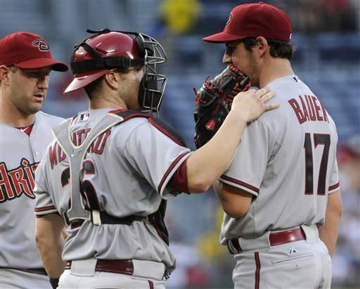 Young, bullpen help Diamondbacks beat Braves