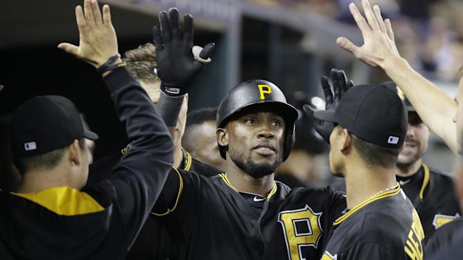 Pittsburgh Pirates' Starling Marte (6) is congratulated after hitting a solo home run against the Detroit Tigers during the eighth inning of a  baseball game Wednesday, July 1, 2015, in Detroit. (AP Photo/Duane Burleson)