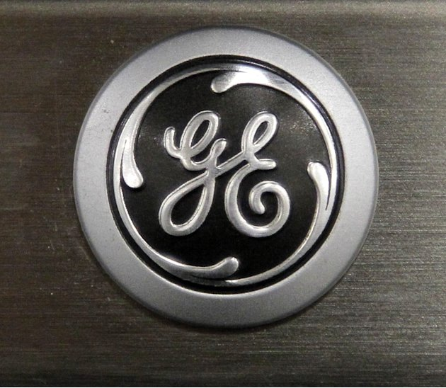 FILE - In this Monday, Sept. 10, 2012 file photo, a General Electric logo is seen on a kitchen stove at a Lowe's store in Framingham, Mass. General Electric Co. is reporting, Friday, Jan. 18, 2013, th