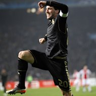 Real Madrid player Gonzalo Higuain celebrates his goal against Ajax during the group D Champions League soccer match between Ajax and Real Madrid at ArenA stadium in Amsterdam, Netherlands, Wednesday, Dec. 7, 2011. (AP Photo/Bas Czerwinski)