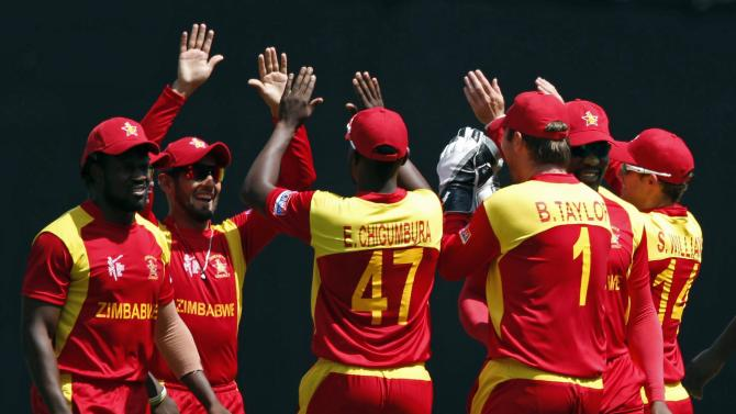 Zimbabwe players celebrate dismissing Pakistan's Jamshed for one run during their Cricket World Cup match at the GABBA in Brisbane