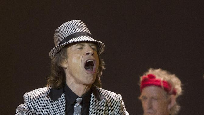 Mick Jagger, left and Keith Richards, of The Rolling Stones perform at the O2 arena in east London, Sunday, Nov. 25, 2012. The band are playing four gigs to celebrate their 50th anniversary, including two shows at London's O2 and two more in New York. (Photo by Joel Ryan/Invision/AP)