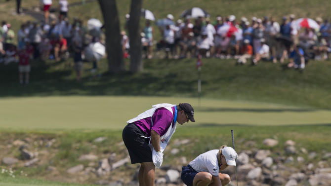Cristie Kerr picks debris away from her ball on the ninth fairway during the second round of the U.S. Women's Open golf tournament, Friday, July 6, 2012, in Kohler, Wis. (AP Photo/Julie Jacobson)